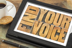 Find your voice concept. Find your voice creativity concept - word abstract in letterpress wood type on a digital tablet with a cup of coffee Stock Photos
