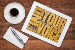 Find your voice concept. Find your voice creativity concept - text in vintage letterpress wood type on a digital tablet with a cup of coffee royalty free stock images