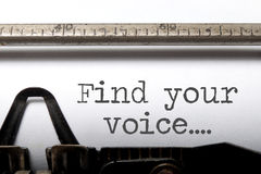 Find your voice inspiration. Find your voice printed on an old fashioned typewriter Stock Photos