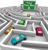 Find Your Way - Cars Lost in Maze. Many colored cars lost in a maze, and a sign marked Find Your Way helps point the way Royalty Free Stock Photos