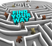 Find Your Way Through a Maze. Many people try to find their way through a deep maze Stock Photos