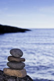 Find your Zen. Zen rocks stacked on boulder at shore of Lake Superior Royalty Free Stock Photo