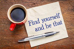 Find yourself and be that. Self discovery concept - handwriting on a napkin with cup of coffee Royalty Free Stock Images