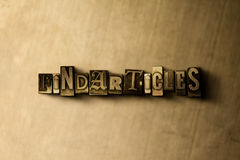 FINDARTICLES - close-up of grungy vintage typeset word on metal backdrop. Royalty free stock illustration.  Can be used for online banner ads and direct mail Stock Image