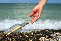 Free Finding A Message In A Bottle Stock Image - 7363471