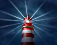 Finding Answers. And business solutions by searching in all directions putting light on new paths to opportunity and success with a lighthouse searchlight Stock Image