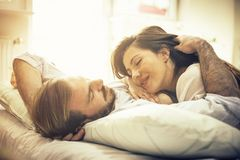Finding comfort in his arms. stock photos