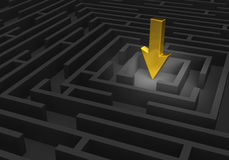 Finding The Goal. A spotlight reveals a large, gold arrow pointing at the center of a dark maze Royalty Free Stock Photography
