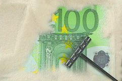 Finding hundred euros. In the sand Royalty Free Stock Images