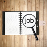 Finding job text on wood plank wall Stock Photos