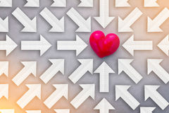 Finding Love concept with paper arrows point to red heart object Royalty Free Stock Image