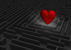 Finding Love. A spotlight reveals a large, red heart at the center of a dark maze Royalty Free Stock Photos