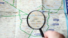 Finding Milano on a map. Man Finding Milano on a map stock video footage