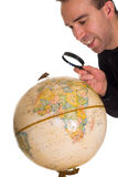 Finding My Town. A man looking at the globe to find the town he lives in Stock Image