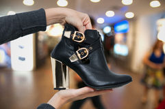 Finding new boots Royalty Free Stock Photography
