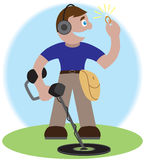 Finding The Prize. Man with metal detector has just found a diamond ring Royalty Free Stock Photography