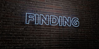 FINDING -Realistic Neon Sign on Brick Wall background - 3D rendered royalty free stock image Stock Images