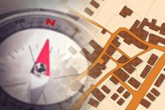 Finding the right home for you! - Concept image with a city map, buildings, roads and navigational compass.  royalty free stock image