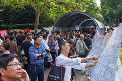 Finding the right match. At matchmaking fair every Saturday morning in People`s Park, Shanghai, China, parents and grandparents scour profiles of eligible Stock Photography