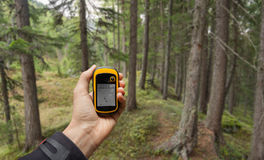 Finding the right position in the forest via gps ( blurred backg Stock Photos