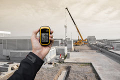 Finding the right position inside a construction site via gps Stock Image