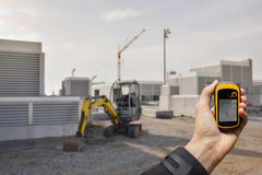 Finding the right position inside a construction site via gps blurred background Stock Photos