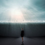 Finding solution. Businesswoman standing near the enter of labyrinth Royalty Free Stock Photography