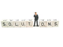 Finding a solution. Businessman trying to find a solution stock photography