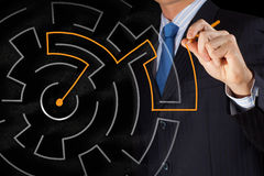 Finding solution. Close up of businessman drawing way out of labyrinth Royalty Free Stock Photo