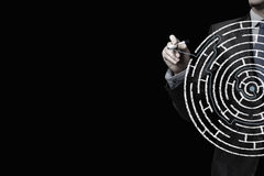 Finding solution. Close up of businessman drawing way out of labyrinth Royalty Free Stock Image