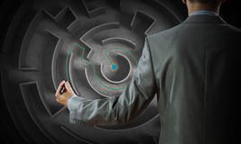 Finding solution. Close up of businessman drawing way out of labyrinth Stock Photo