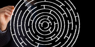 Finding solution. Close up of businessman drawing way out of labyrinth Stock Photos