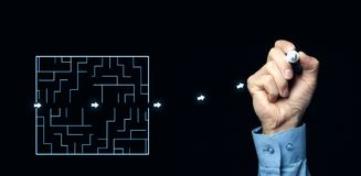 Finding the solution of a labyrinth. Business concept Stock Images