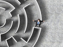 Finding the solution. Top view of successful businessman lost in labyrinth Stock Photography