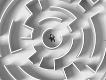 Finding the solution. Top view of successful businessman standing in center of labyrinth Stock Photos