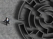 Finding the solution. Top view of successful businessman standing near the entrance of labyrinth Stock Photography