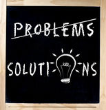 Finding Solutions For Problems on Chalkboard Royalty Free Stock Image