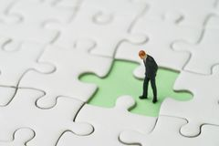 Free Finding The Missing Piece For Business Success Concept, Miniature People Businessman Standing And Looking At The Missing White Royalty Free Stock Photos - 110792598