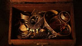 Finding a Treasure Chest. Night scene. Close-up. Opening and closing the treasure chest in candlelight stock footage