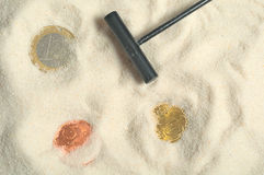 Finding treasure with euros. In the sand Stock Photography