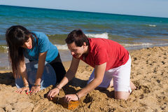 Finding a treasure on the sand Royalty Free Stock Image