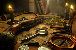 Finding treasures. Pirate's accessories on a table Stock Image