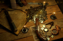 Finding treasures 2. Pirate's accessories on a table upside Stock Photo