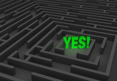 Finding The Way To Yes. A bright, green YES stands at the center of a dark maze Royalty Free Stock Photos
