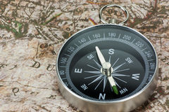 Finding Your Direction - Compass and Map Stock Images