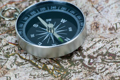 Finding Your Direction - Compass and Map Royalty Free Stock Photos