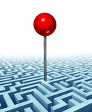 Finding Your Goal. In life and in business with a concept of a red location direction pin in the middle of a complicated three dimensional maze or labyrinth as Stock Image