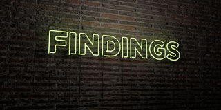 FINDINGS -Realistic Neon Sign on Brick Wall background - 3D rendered royalty free stock image Stock Images