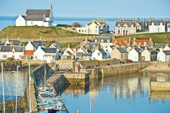 Findochty historic fishing port. Showing the prominent whitewashed church overlooking the sea Royalty Free Stock Image