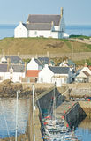 Findochty historic fishing port. Showing the prominent whitewashed church overlooking the sea Royalty Free Stock Images